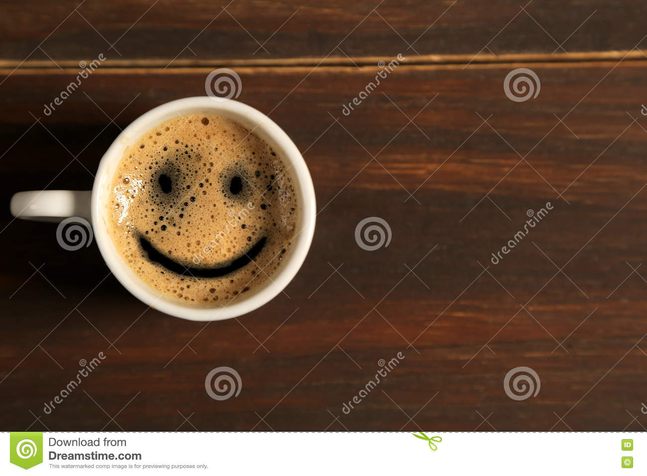 Good morning coffee smile cup on wooden background