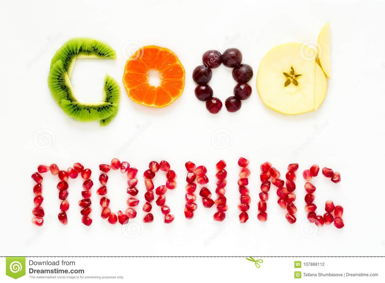 Good morning concept. `Good morning` words laid out with pieces of fruit and pomegranate seeds