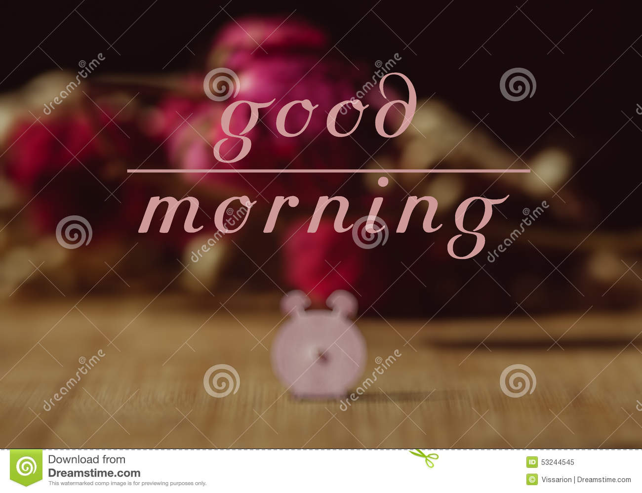 Good morning. Text in front of background with pink alarm clock royalty free stock photo