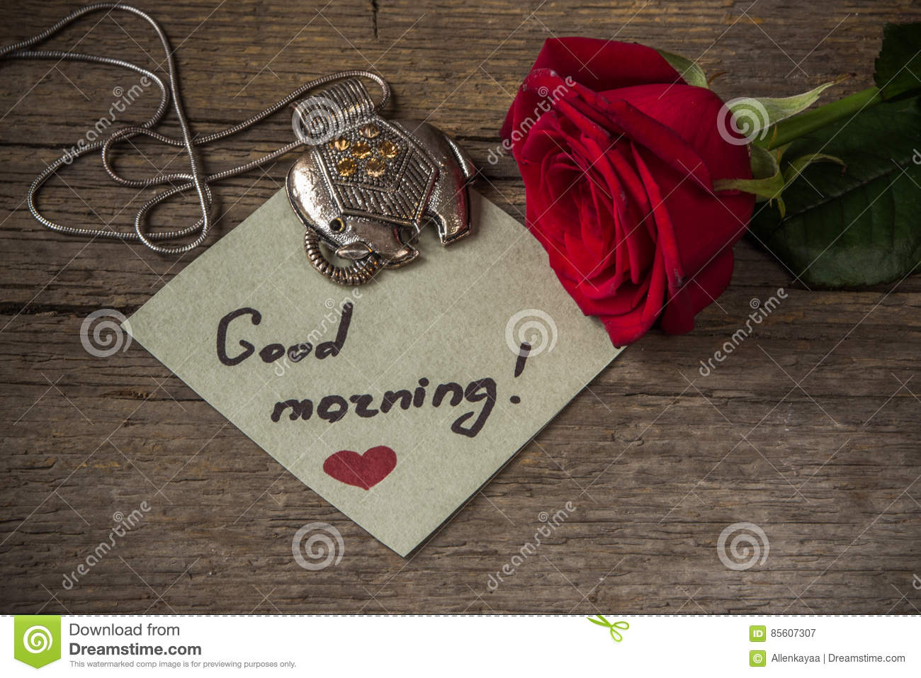 good morning text on a paper red rose flower and decoration el