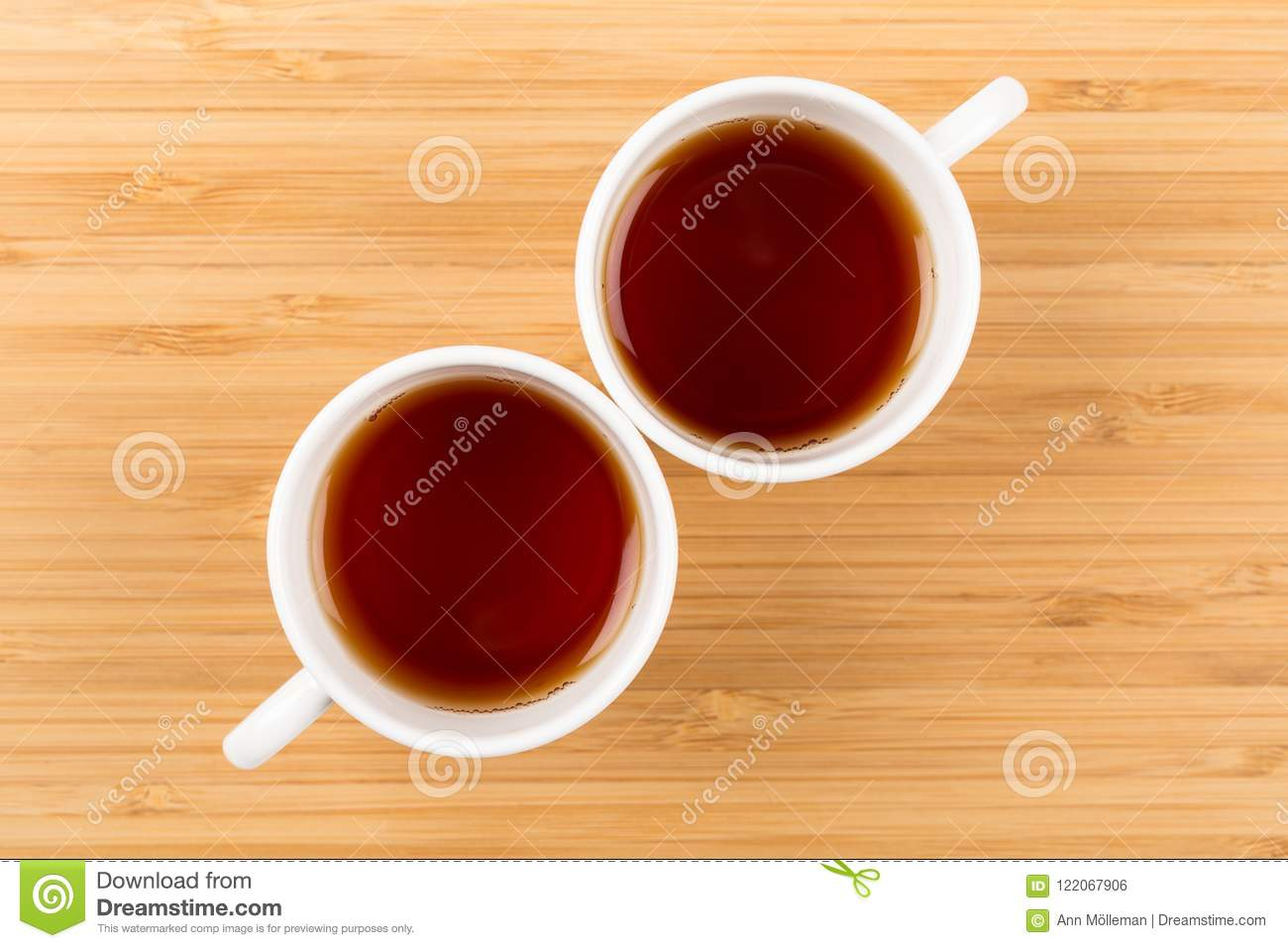 Good Morning, Two White Cups of tea isolated on a wooden background shot from above, breakfast