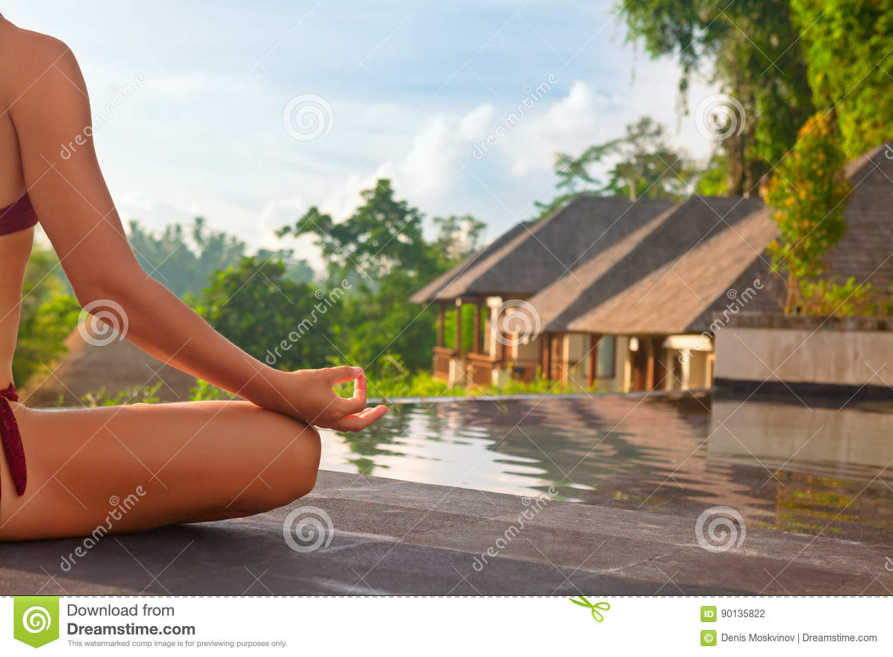 Good morning with woman yoga meditating on sunrise background.