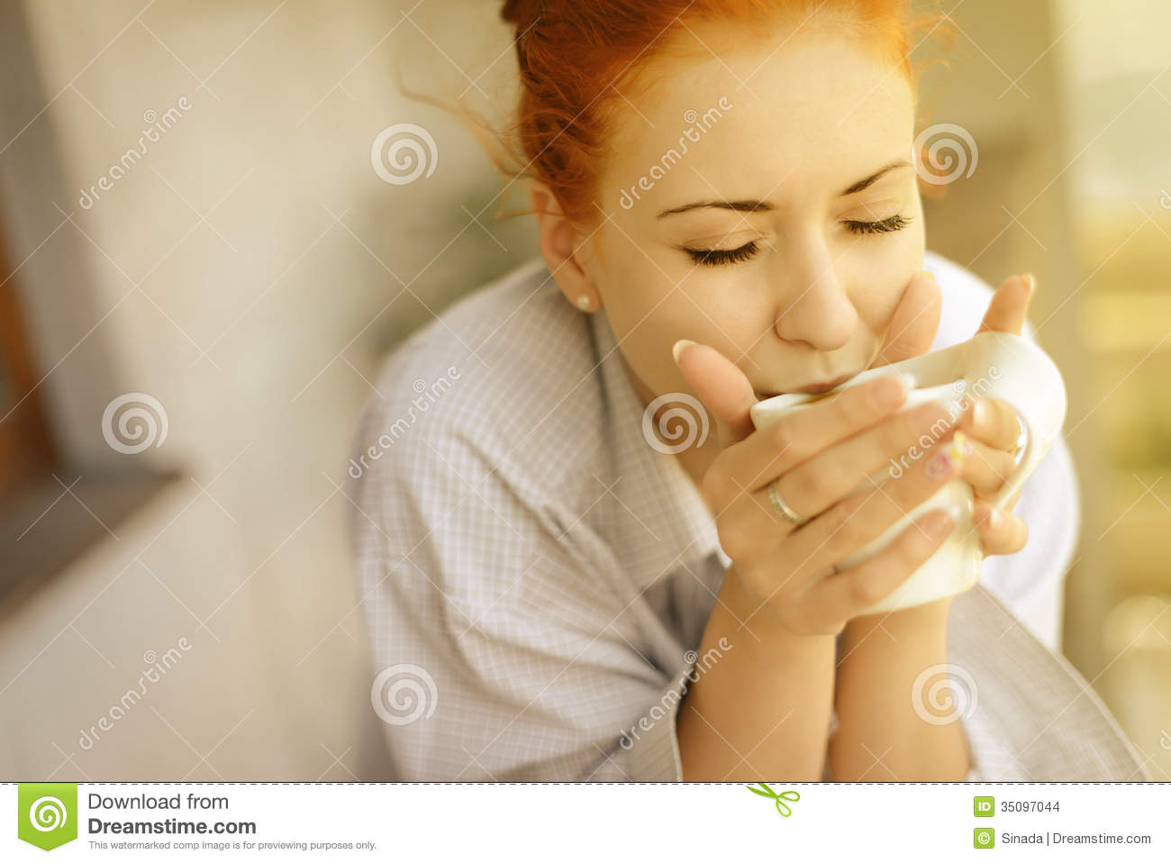 Stock images good morning womans with cup of fragrant coffee