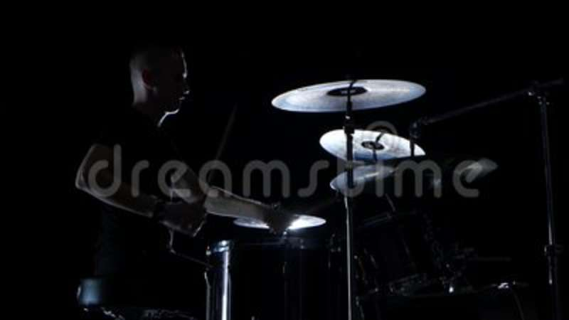 good music in the performance of a professional drummer side view black background stock video video of fraction knock 97520815