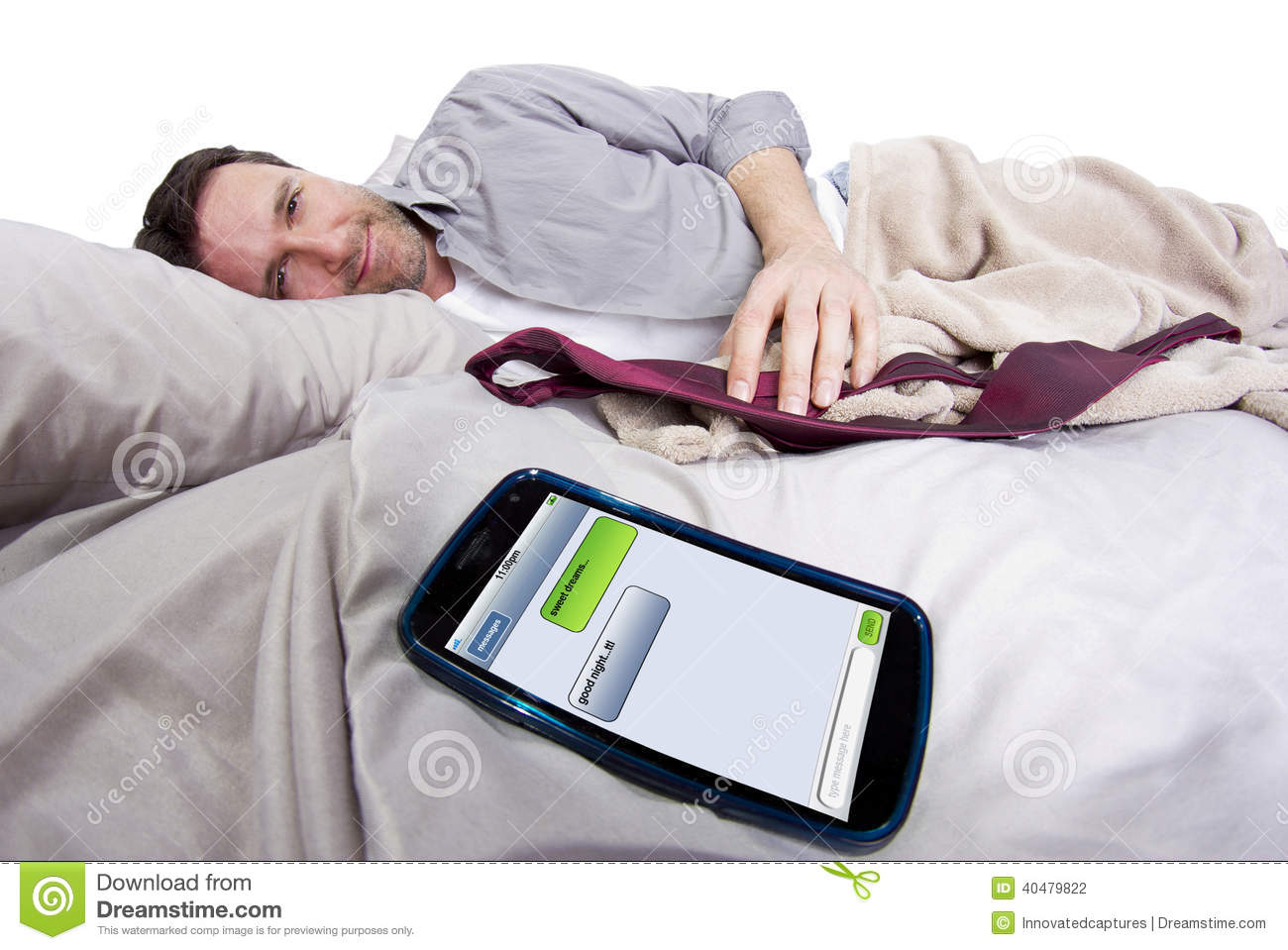 Good night text messages stock photo image 40479822 for Cell phone bed