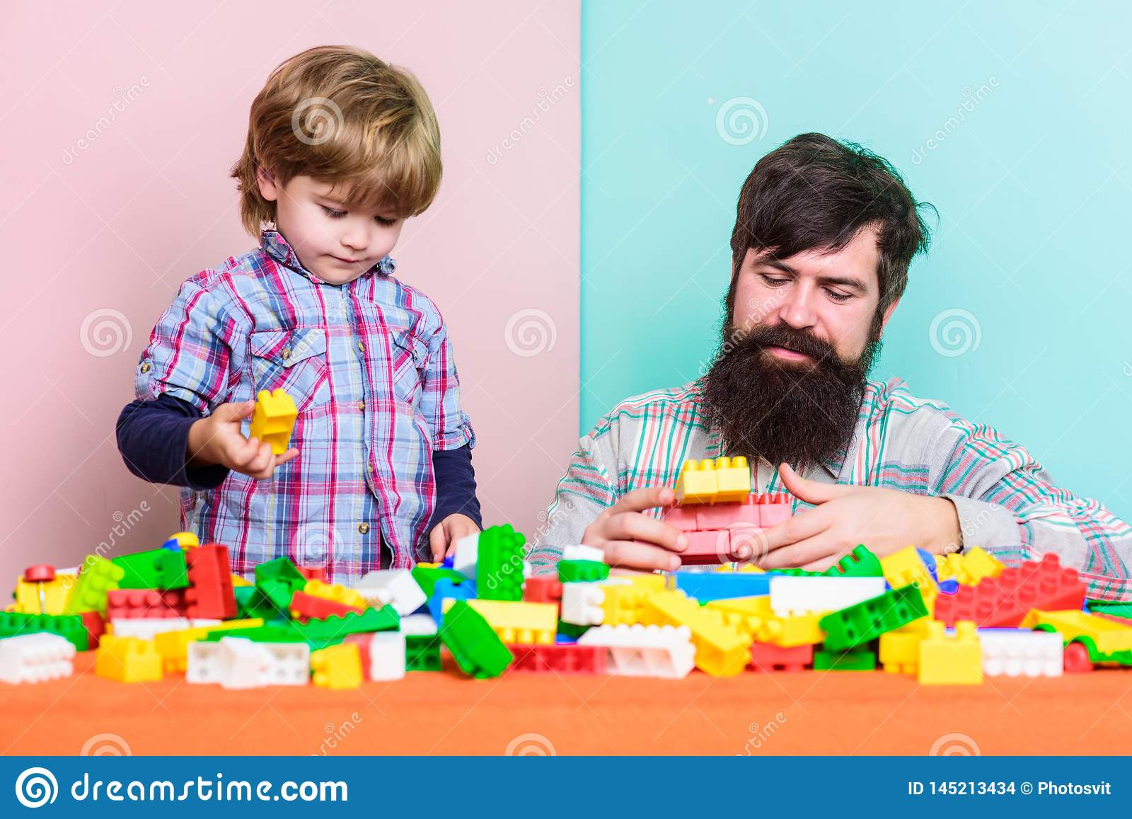 Good parenting concept. small boy with dad playing together. father and son play game. happy family leisure. love. child