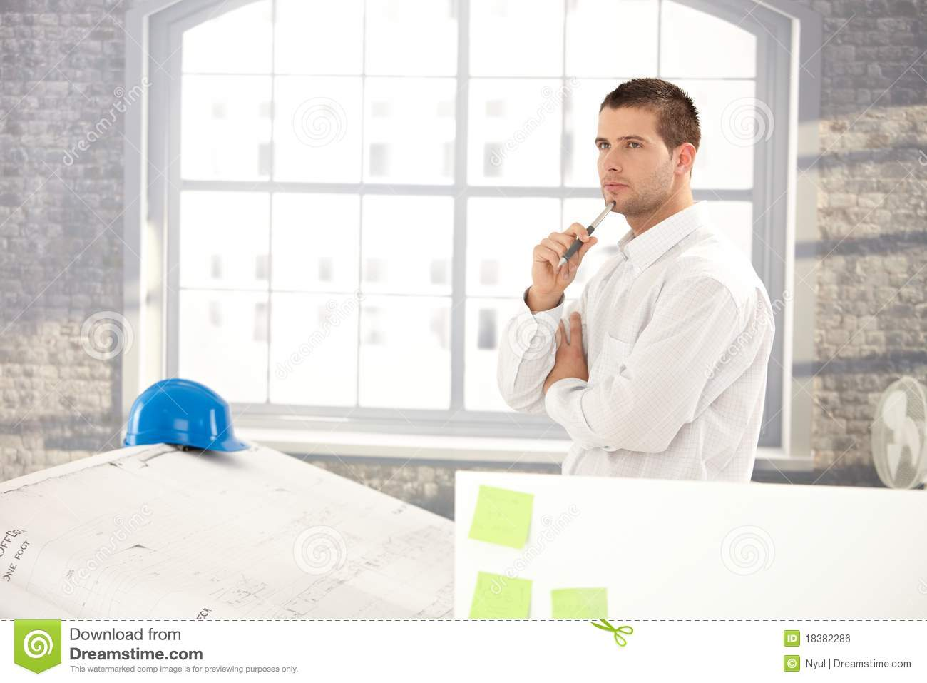 Goodlooking Architect Making Plans Royalty Free Stock Image - Image ...