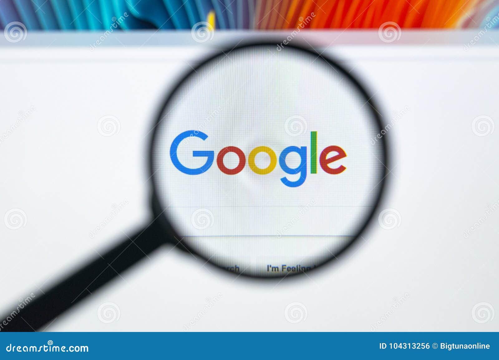 Google-homepage auf dem Bildschirm Apples IMac unter einer Lupe Google ist Welt-` s die meiste populäre Suchmaschine