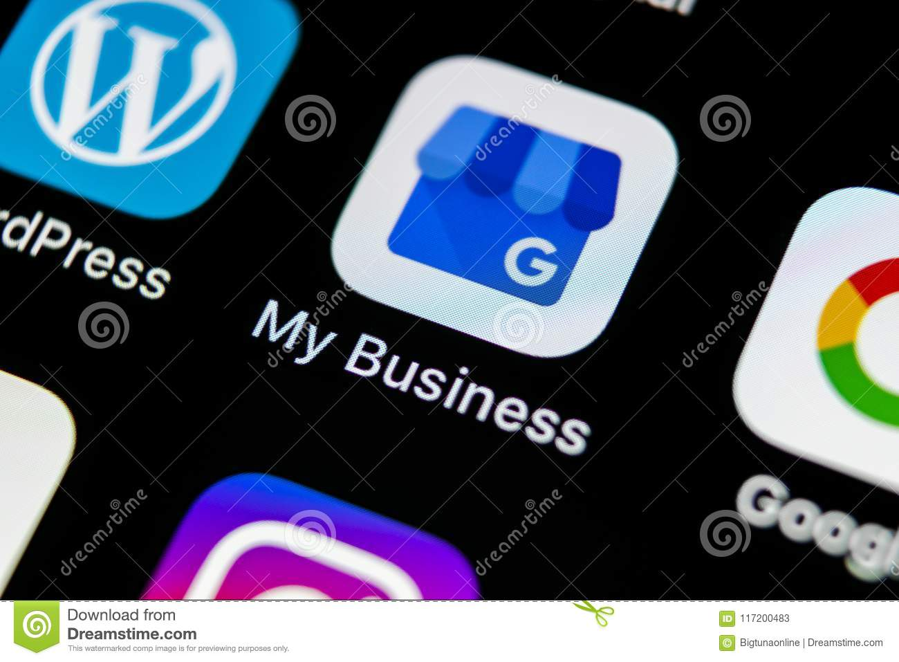 Google My Business application icon on Apple iPhone X screen close-up. Google My Business icon. Google My business application. So