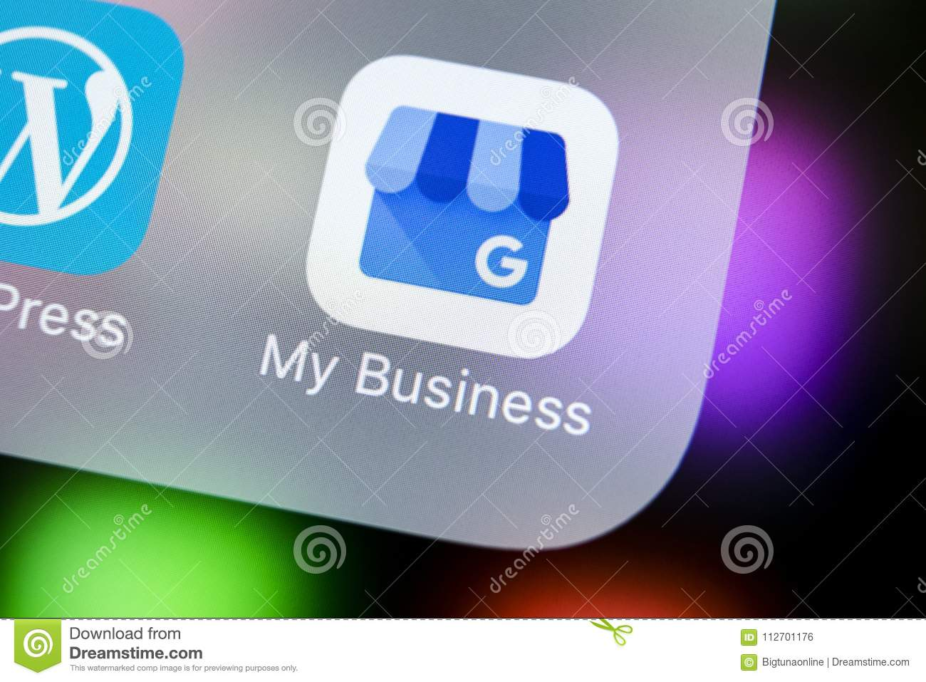 Google My Business application icon on Apple iPhone X screen close-up. Google My Business icon. Google My business application.