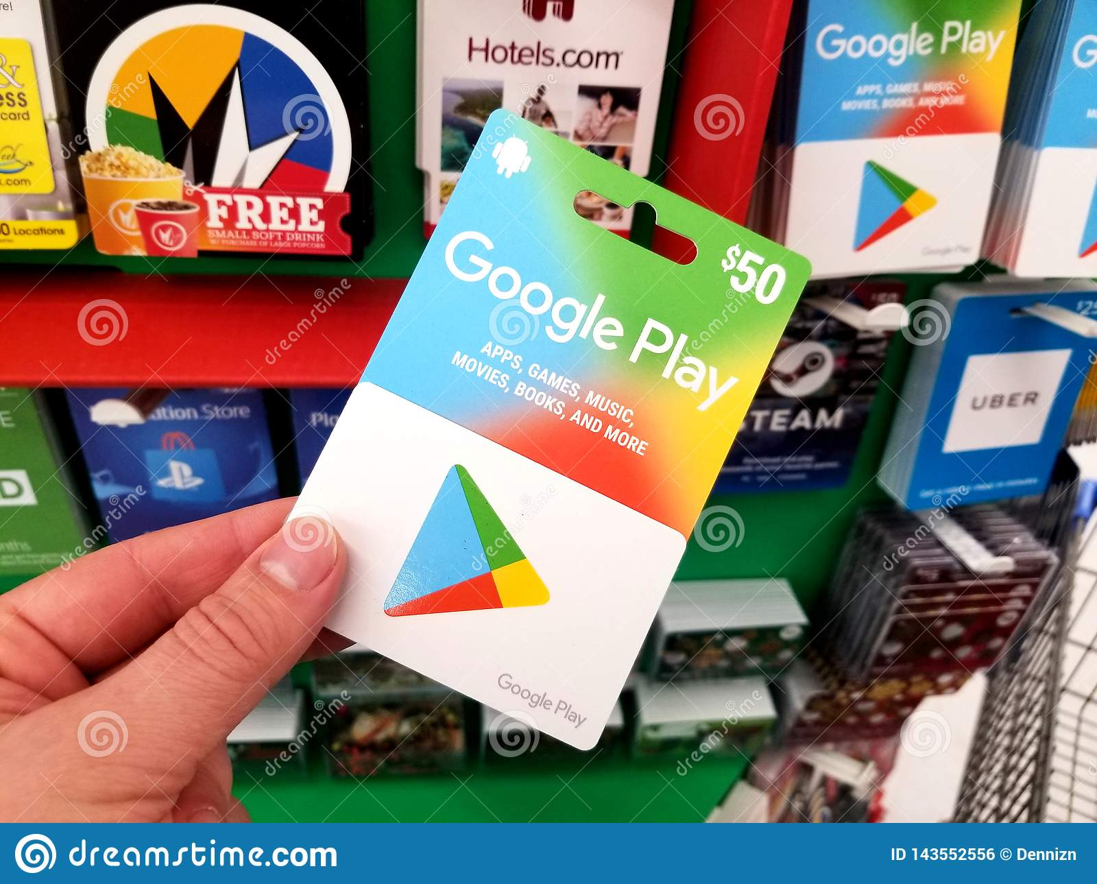 Google Play Gift Card In A Hand Editorial Photo - Image of discount