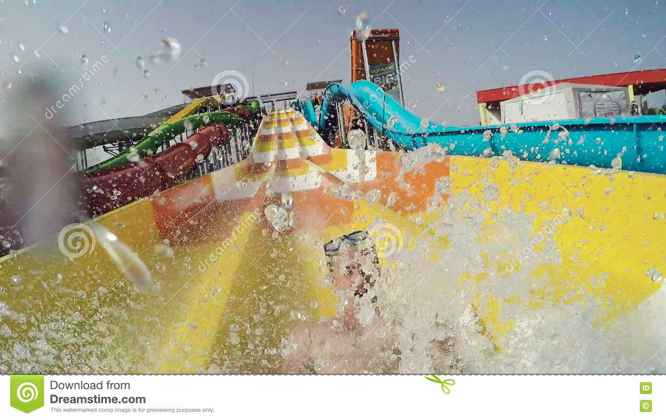 5562007e08f GoPro. Man Sliding Down The Waterslide In A Waterpark Stock Footage - Video  of outdoors, happiness: 73747762