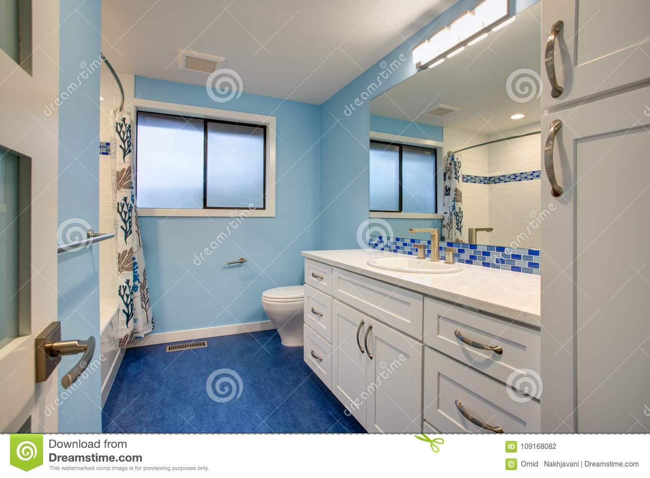 - Gorgeous Bathroom With Blue Walls Stock Photo - Image Of