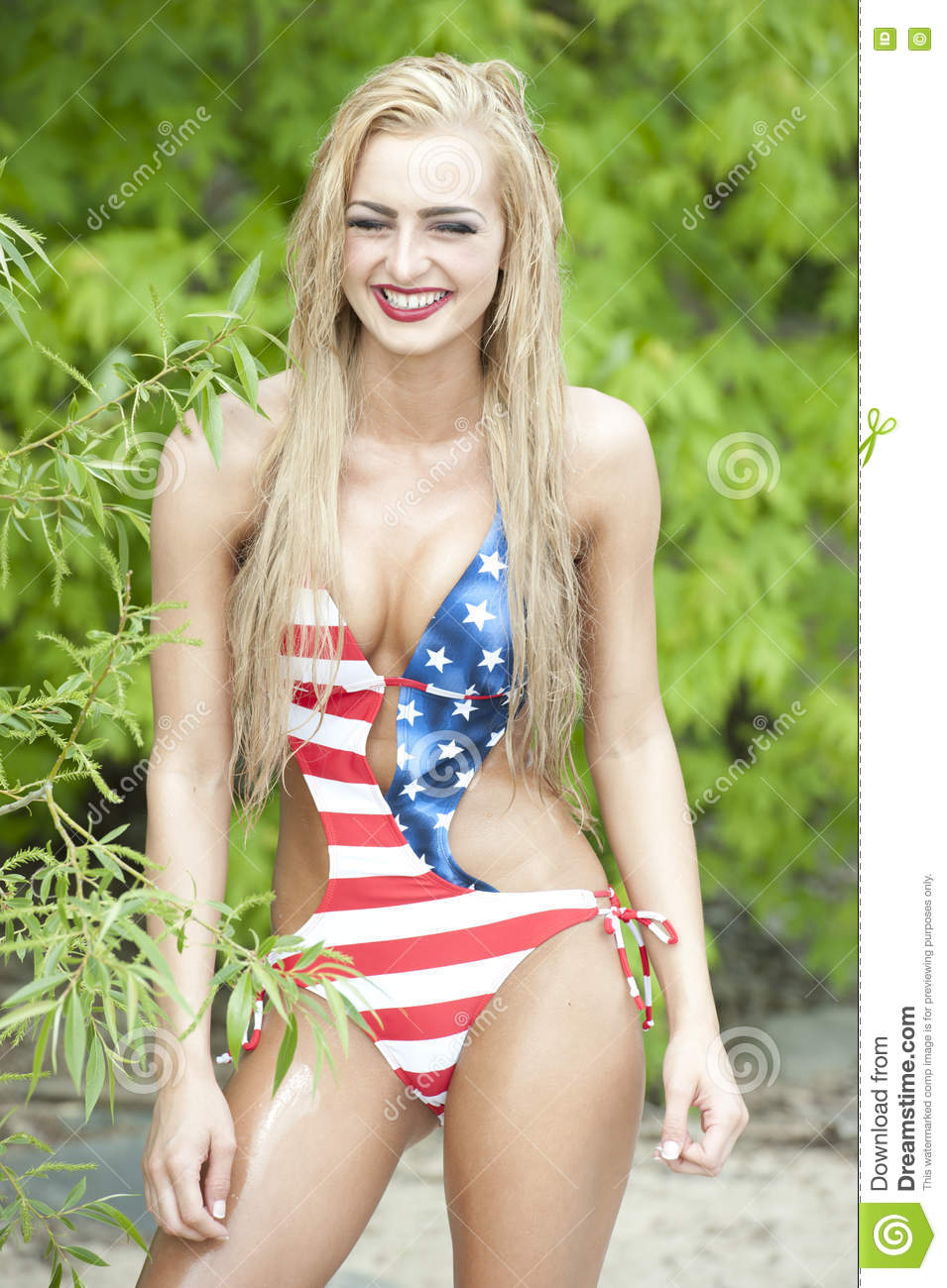 Gorgeous Blonde Laughing Wearing American Flag Swimsuit