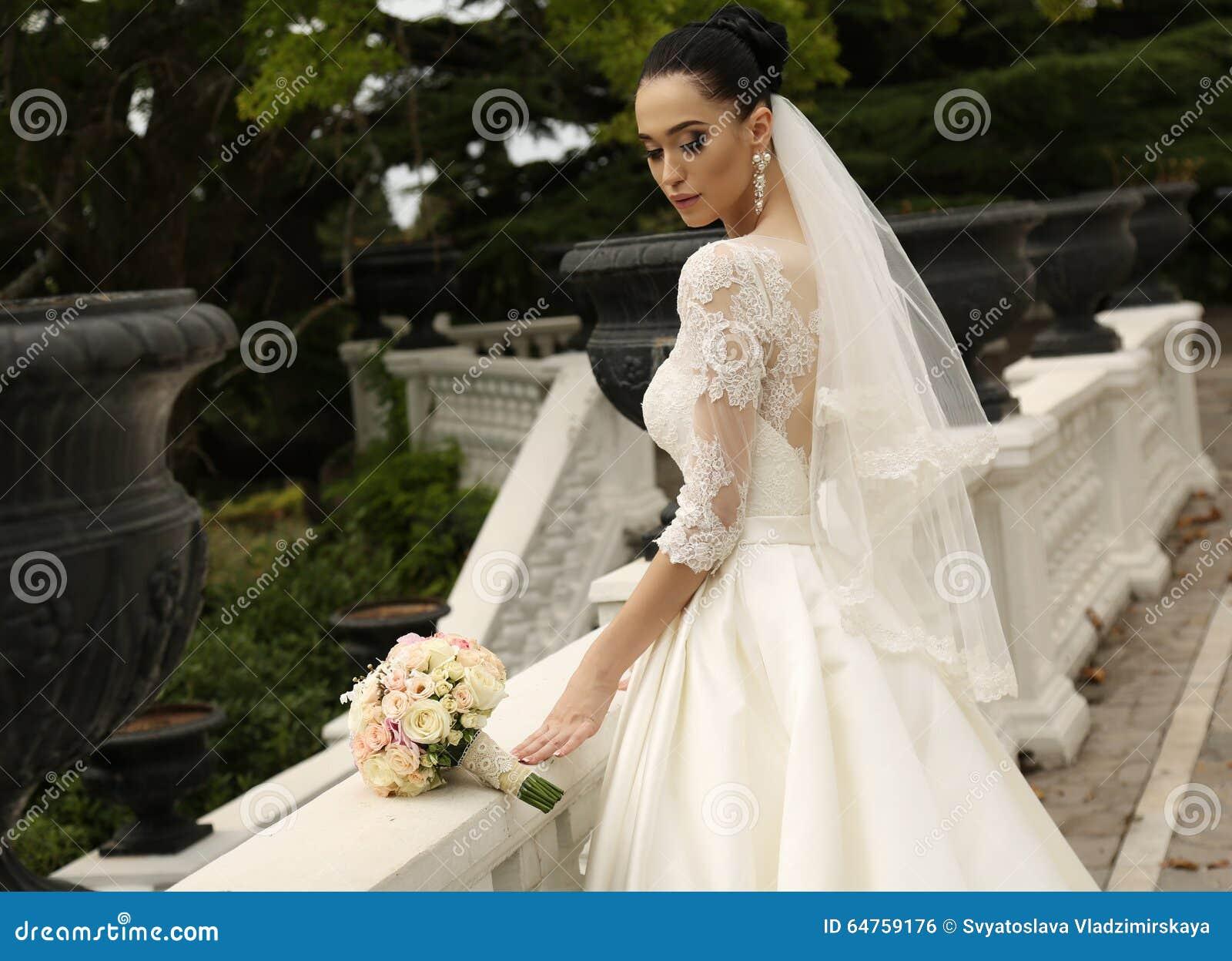 Gorgeous Bride With Dark Hair Wears Elegant Wedding Dress