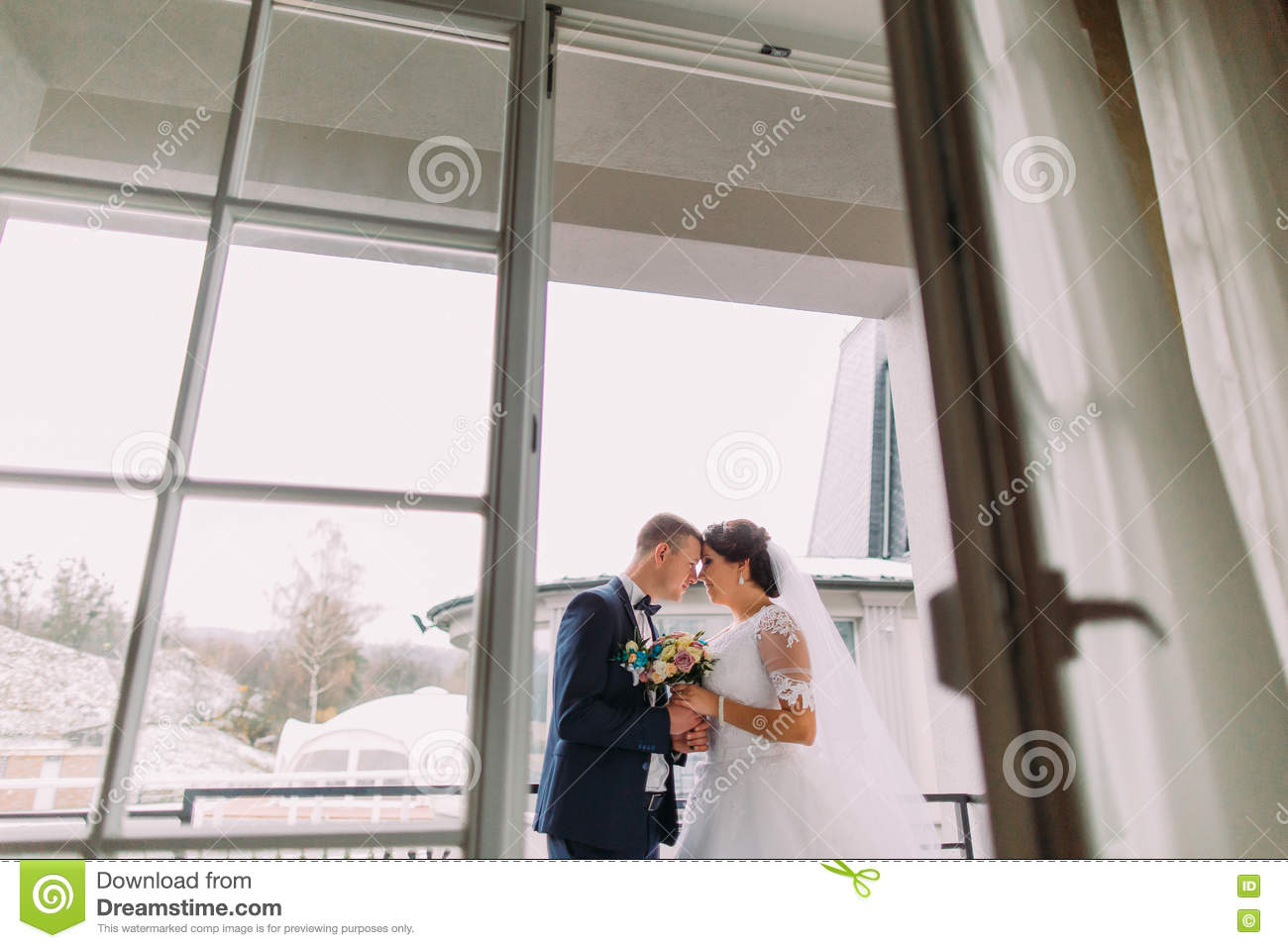 Gorgeous bride and elegant groom posing on balcony for Balcony concept
