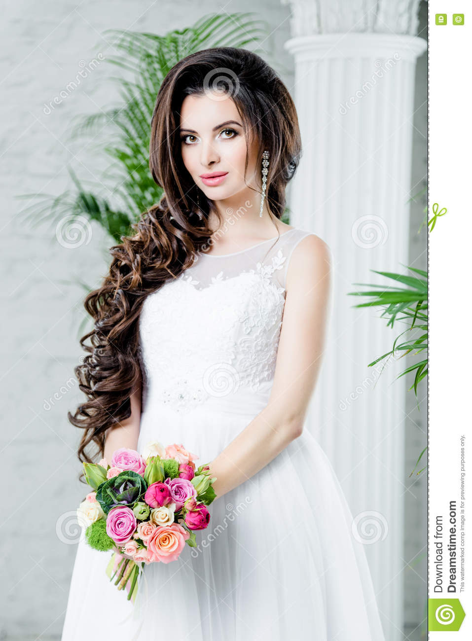 e29995e6cc94 Gorgeous bride in luxury wedding dress. Bride. Perfect Creative Make up and  Long Wavy Hair. Hairstyle, wedding jewelry. Beautiful Woman with Shiny  Brown ...