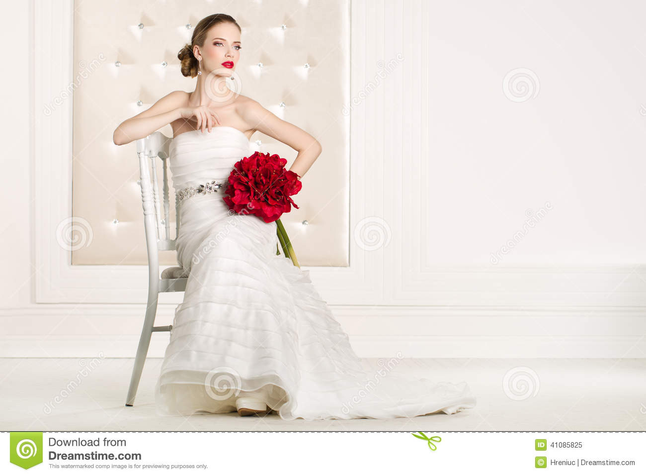Gorgeous Bride With White Dress With Red Flowers Bouquet Stock Image
