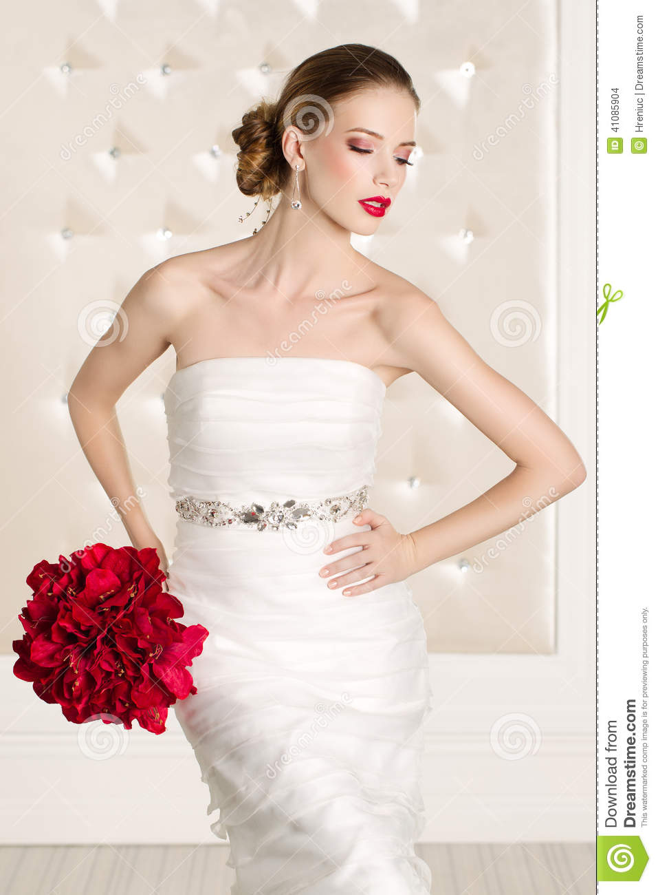 Gorgeous Bride With White Dress With Red Flowers Bouquet Stock Photo