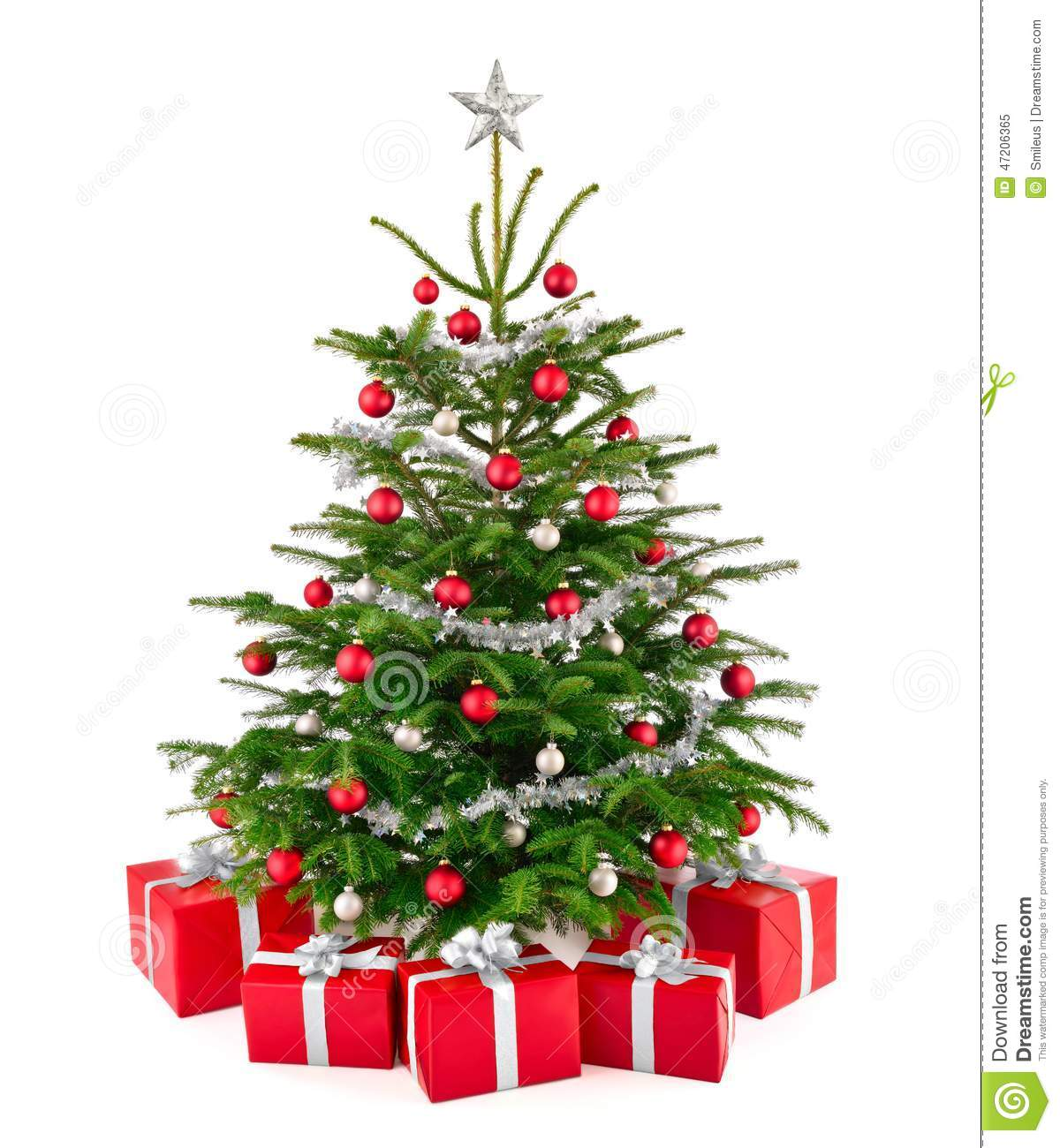 Lush christmas tree with colorful gift boxes royalty free