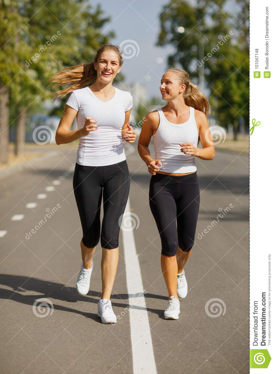 Gorgeous Girls Running On The Blurred Background. Sporty Youth. Morning  Jogging Concept. Stock Photo - Image of funny, lifestyle: 101047148