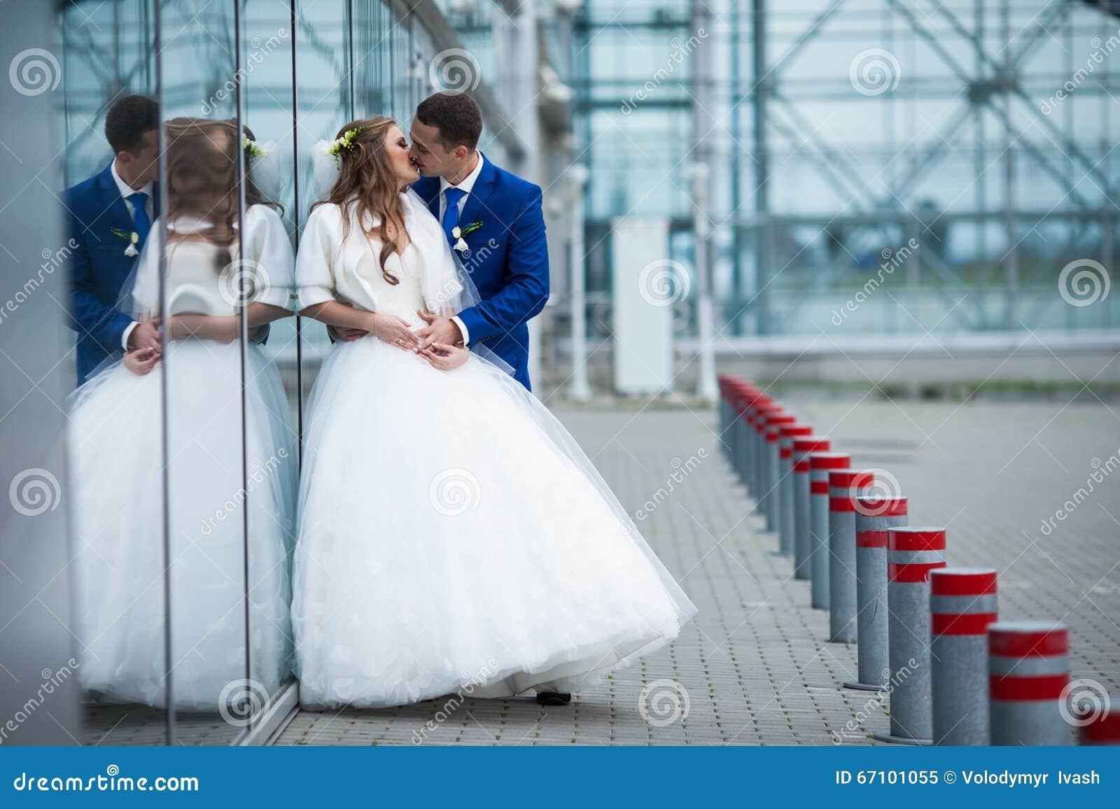 Gorgeous Happy Brunette Bride And Elegant Groom In Blue Suit Hug ...