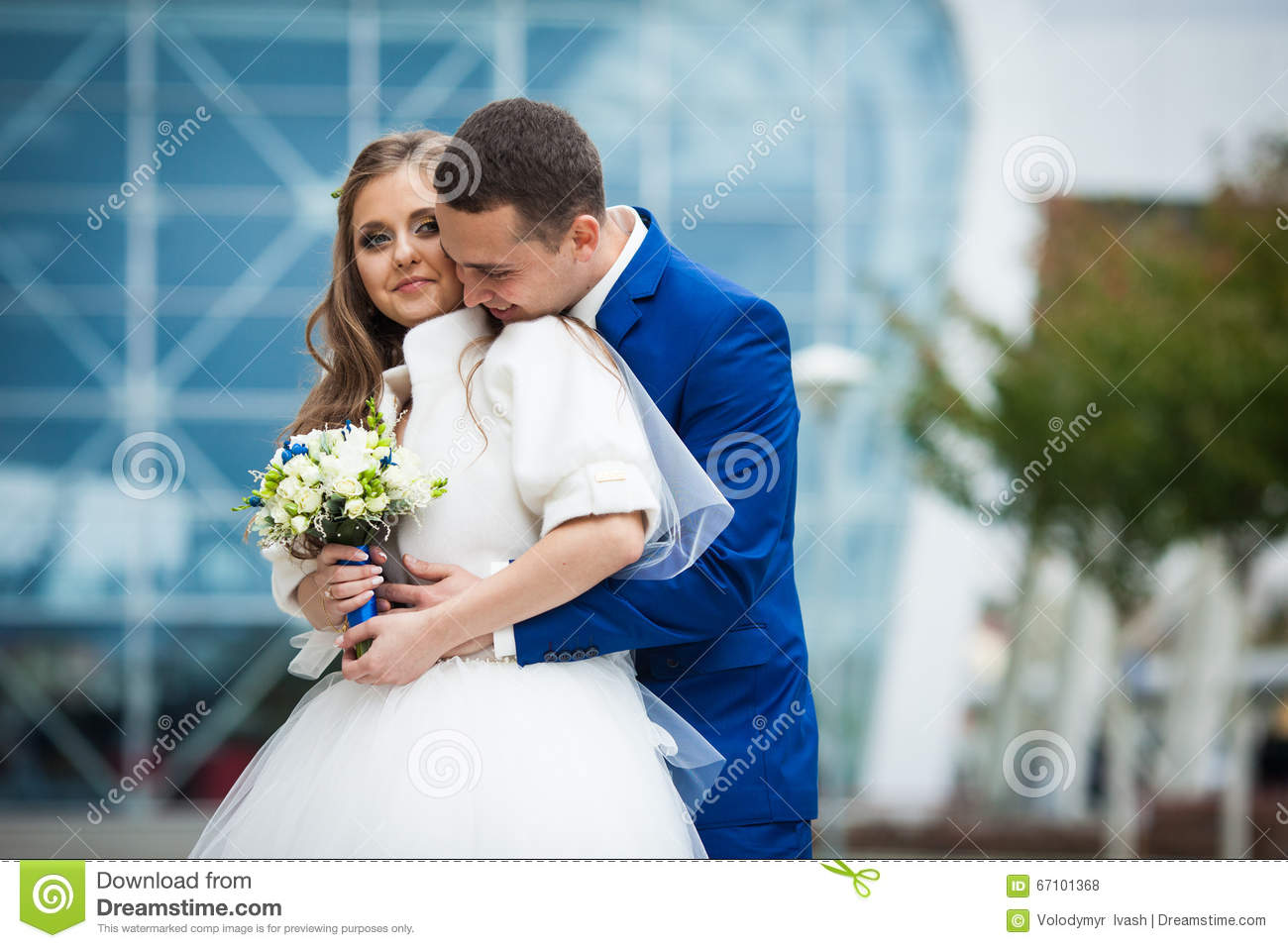 Gorgeous Happy Brunette Bride And Elegant Groom In Blue Suit Wit ...