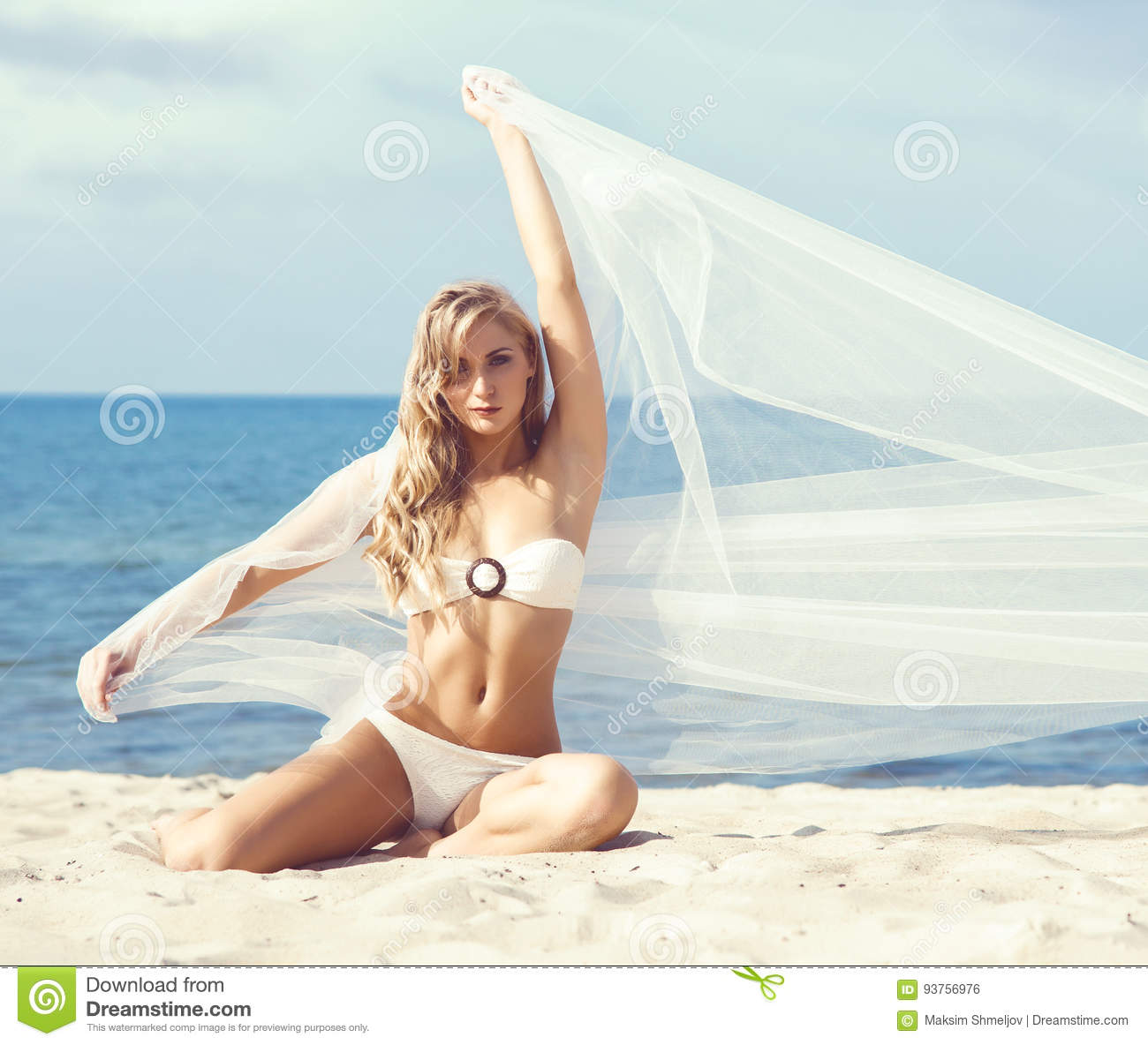 Attractive Slim And Woman In Alluring Bikini Posing With A Blowing Fabric On The Beach Traveling Vacation Concept