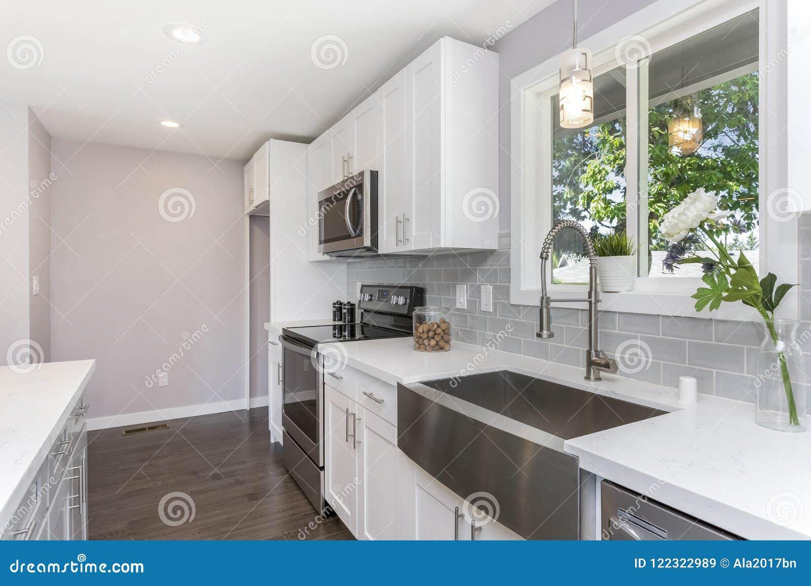 Gorgeous kitchen with a farm sink.