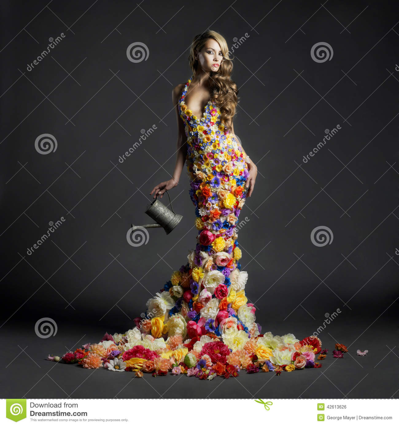Gorgeous lady in dress of flowers
