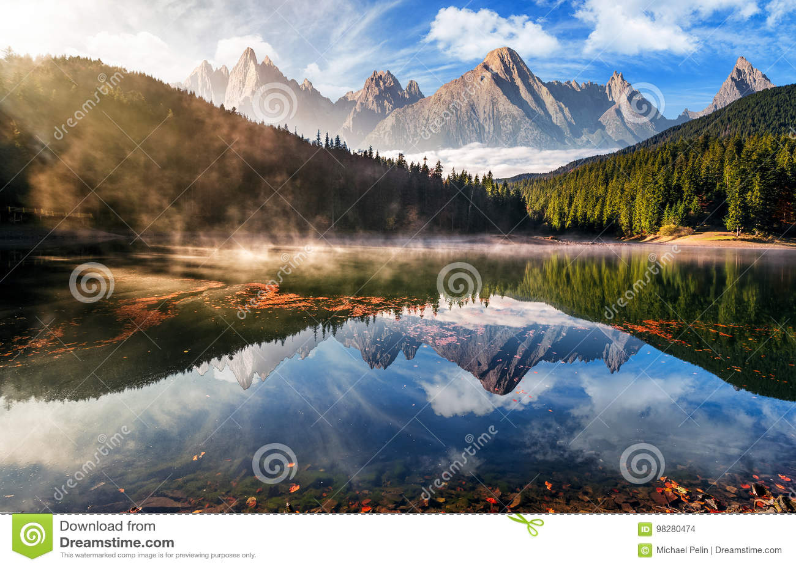 Gorgeous mountain lake in autumn fog