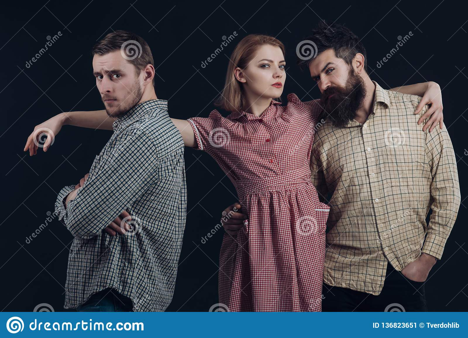 Gorgeous 50s styling with plaid print. Sensual woman and men in retro style. Classic fashion collection. Fashion models