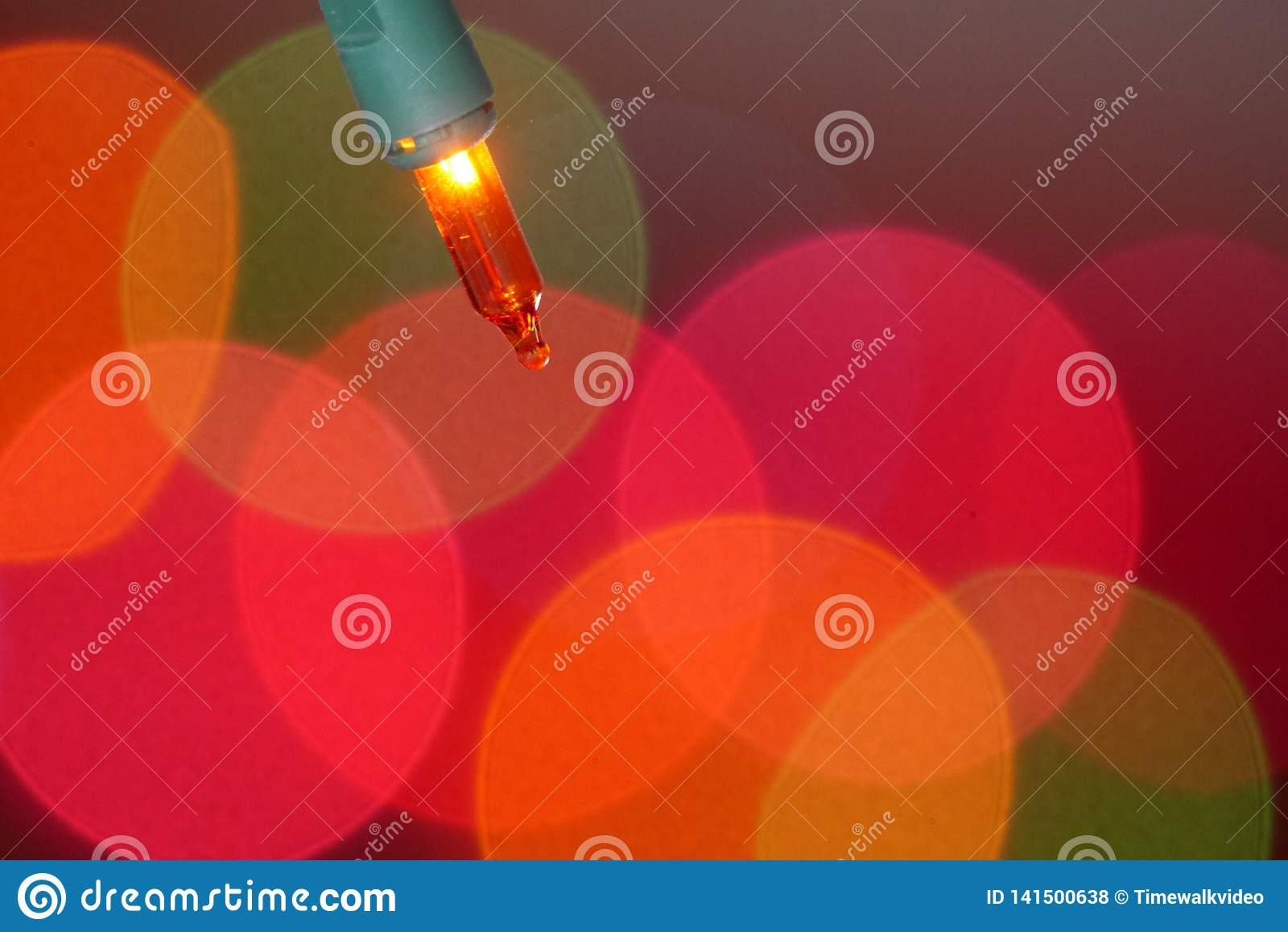 Gorgeous shot of Orange Christmas tree lightbulb