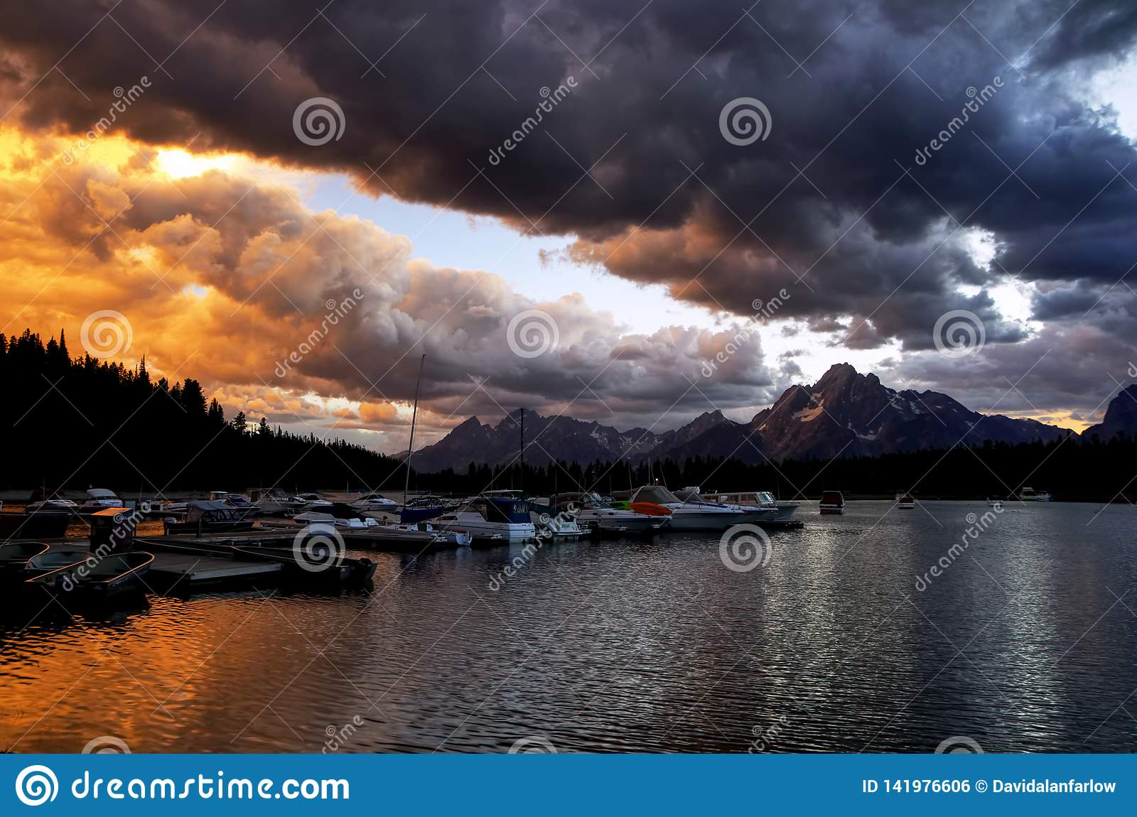 Sunset over Jackson Lake with Grand Tetons in background