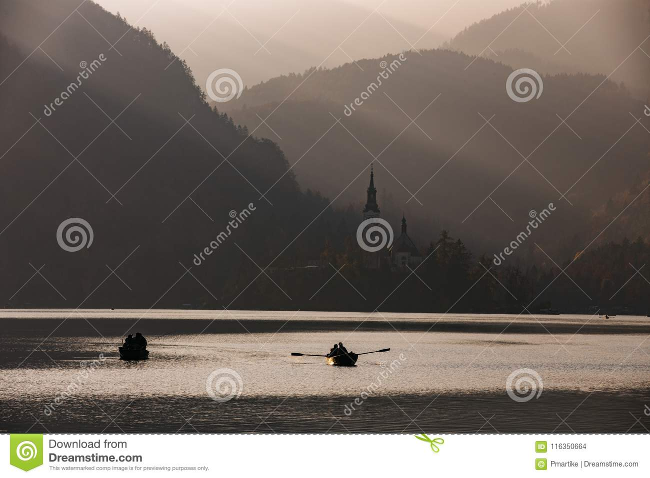 Bled Lake in the sunset with boat