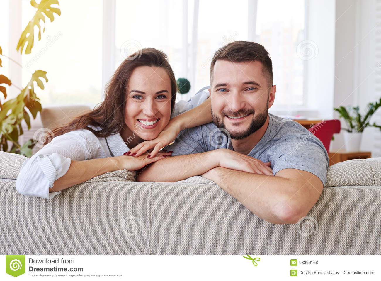 Download Gorgeous Wife And Husband Spending Free Time Relaxing On Sofa Stock Photo Image Of