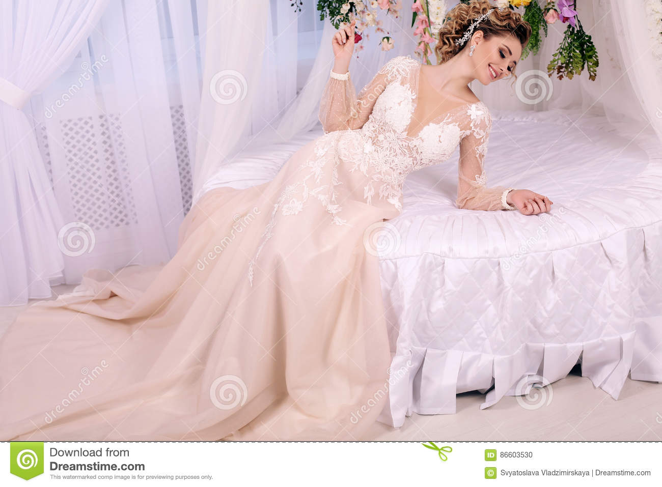 Gorgeous woman with blond hair in luxurious wedding dress