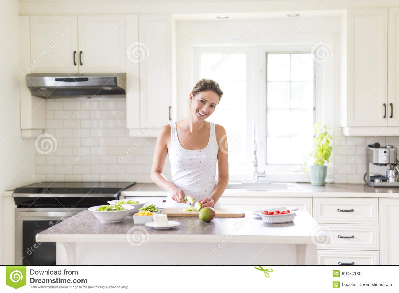 Gorgeous Woman Doing A Salad In Her Kitchen Stock Photo - Image of ...