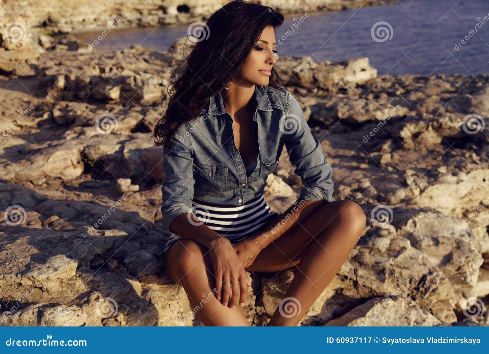 Hair Style Jeans: Gorgeous Woman With Long Dark Hair Posing On Sea Coast