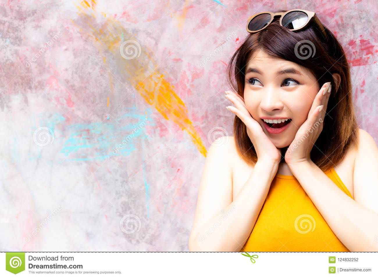 Gorgeous woman is looking at copy space. Charming beautiful woman acts like a surprise, happy, shock, admire or wow some goods, p