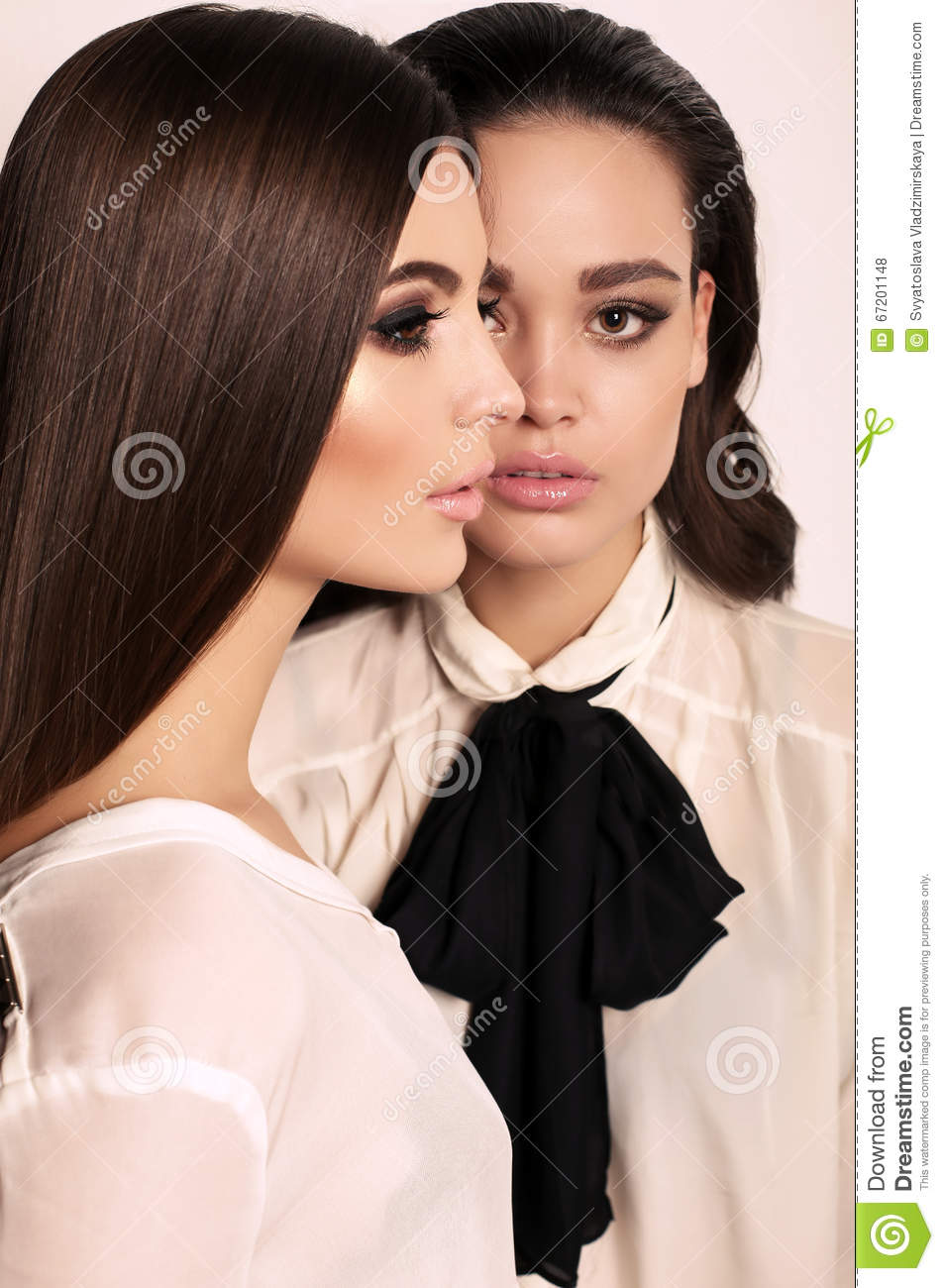 Gorgeous Women With Dark Hair And Evening Makeup Stock Photo Image