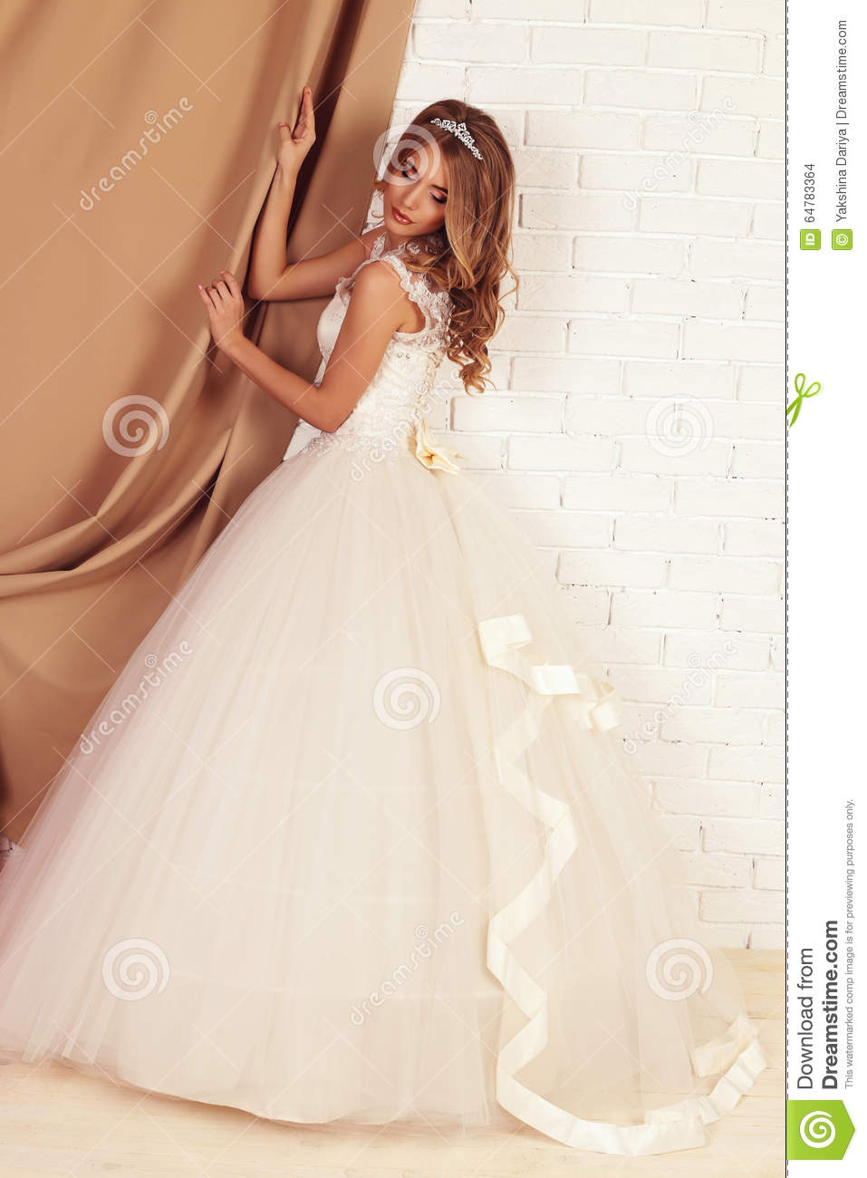 Gorgeous Young Bride With Blond Curly Hair, Wears Elegant Wedding ...