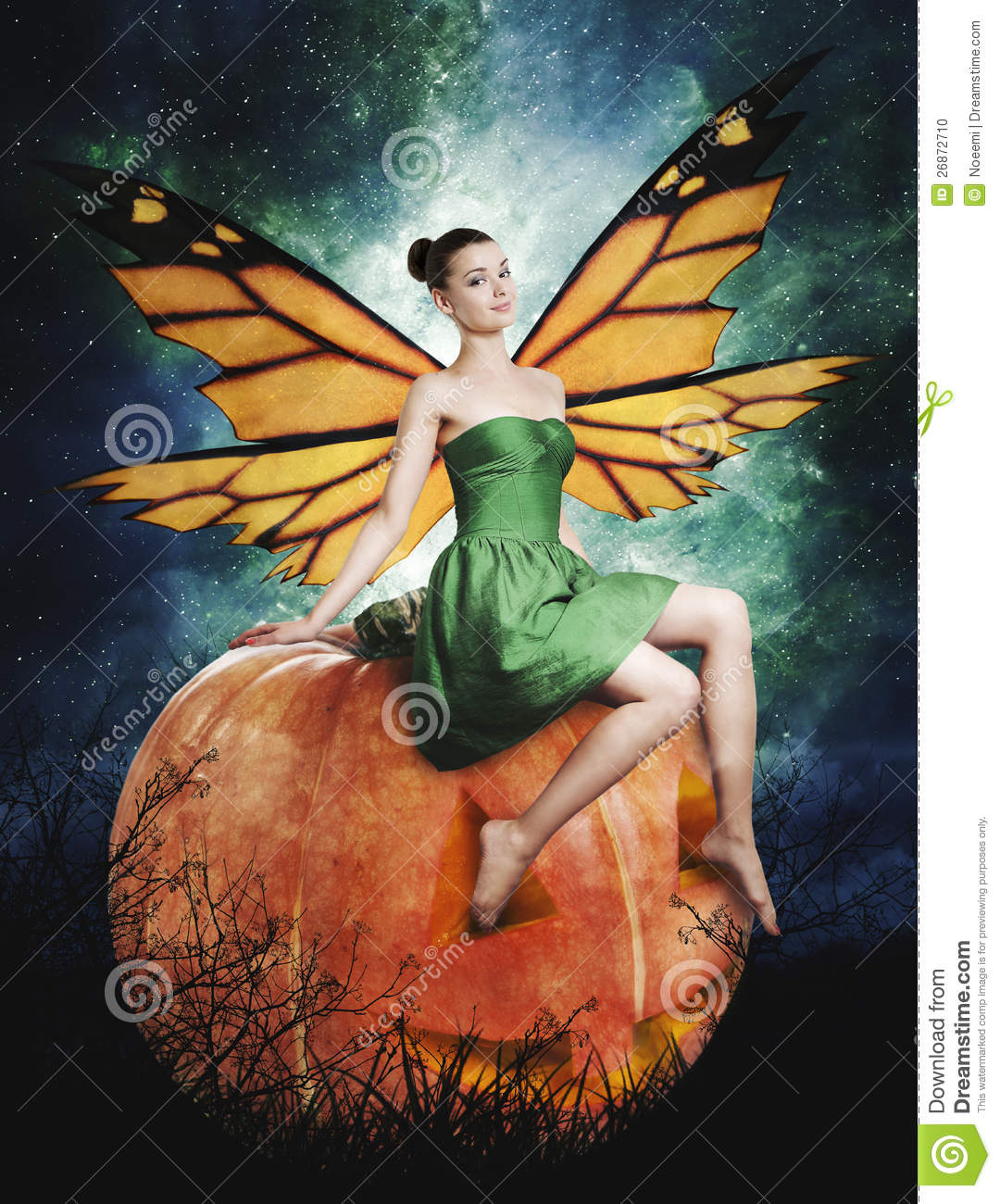 gorgeous young woman as halloween pumpkin fairy stock
