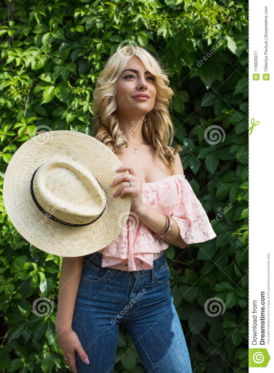 Gorgeous Young Woman Wearing Straw Hat And Lace Blouse With Nake