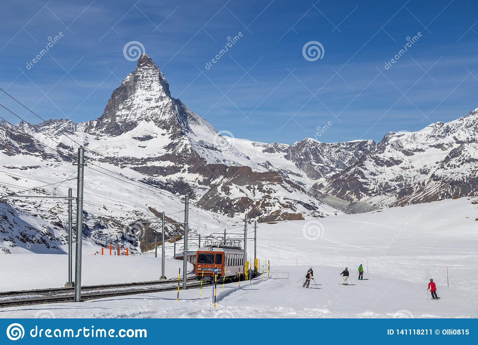 Gornergrat Train and people skiing in front of Matterhorn