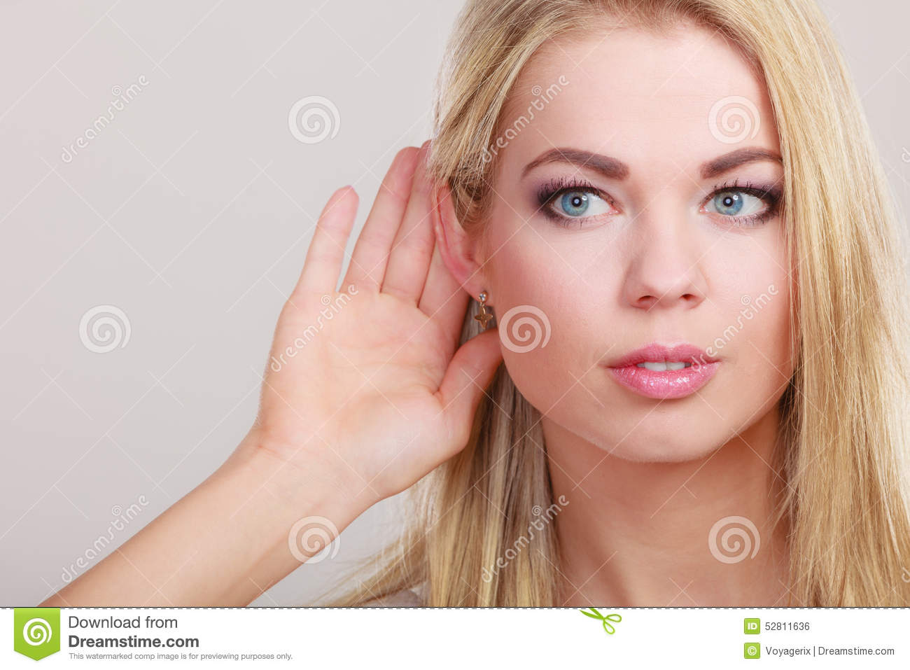 Gossip girl with hand behind ear spying