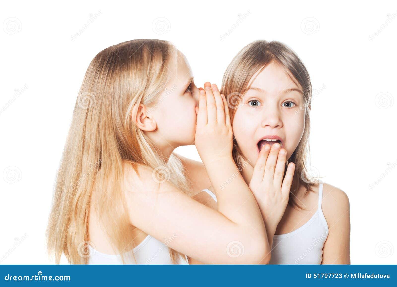 Gossip. Girl whispers to the friend secrets