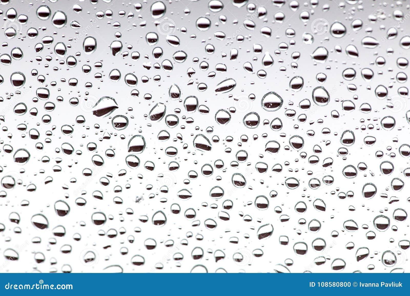 Gotas da chuva no vidro, fundo textu do fundo da gota da água