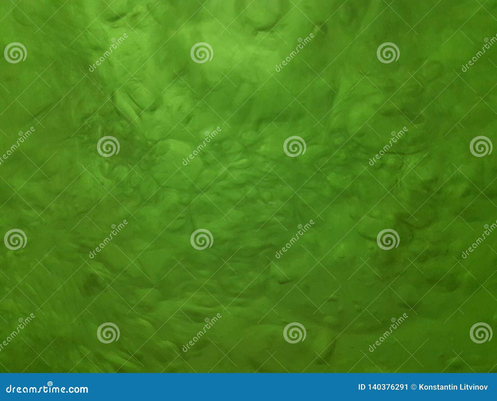 Gotas de borbulhagem da água com máscaras do verde, textura