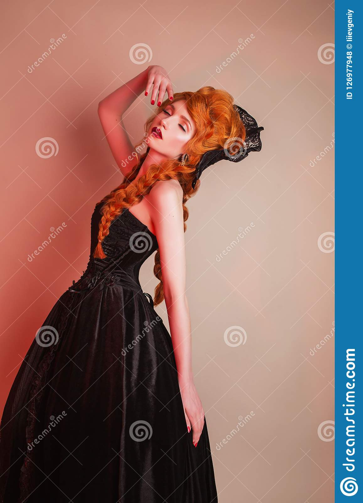 Gothic carnival clothes. Young dancing redhead queen with hairstyle. Princess with red hair. Vampire with pale skin. Mystical outf